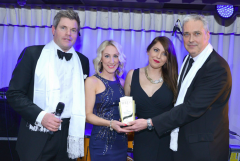 Celebrity presenter Mark Durden-Smith and Cunard's Jeremy Mckenna presenting Bolsover Cruise Club's Katie Anderson & Rebecca Martin with the award.